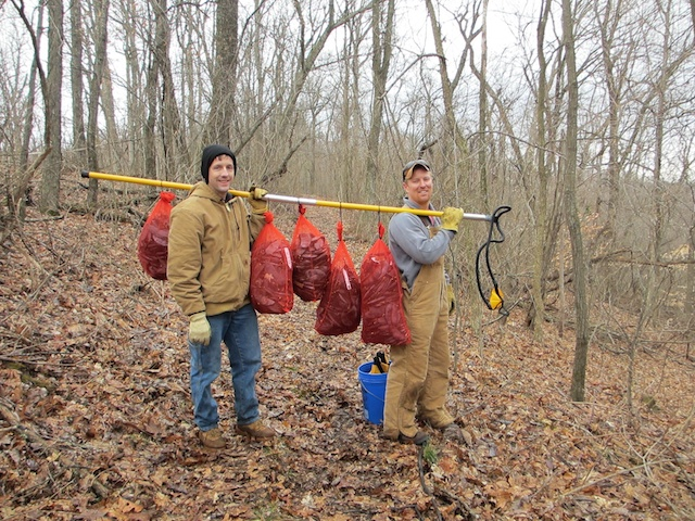 Andy Schmitz and Jeff Carstens with a bounty of seedpods.    Schmitz and Carstens photo