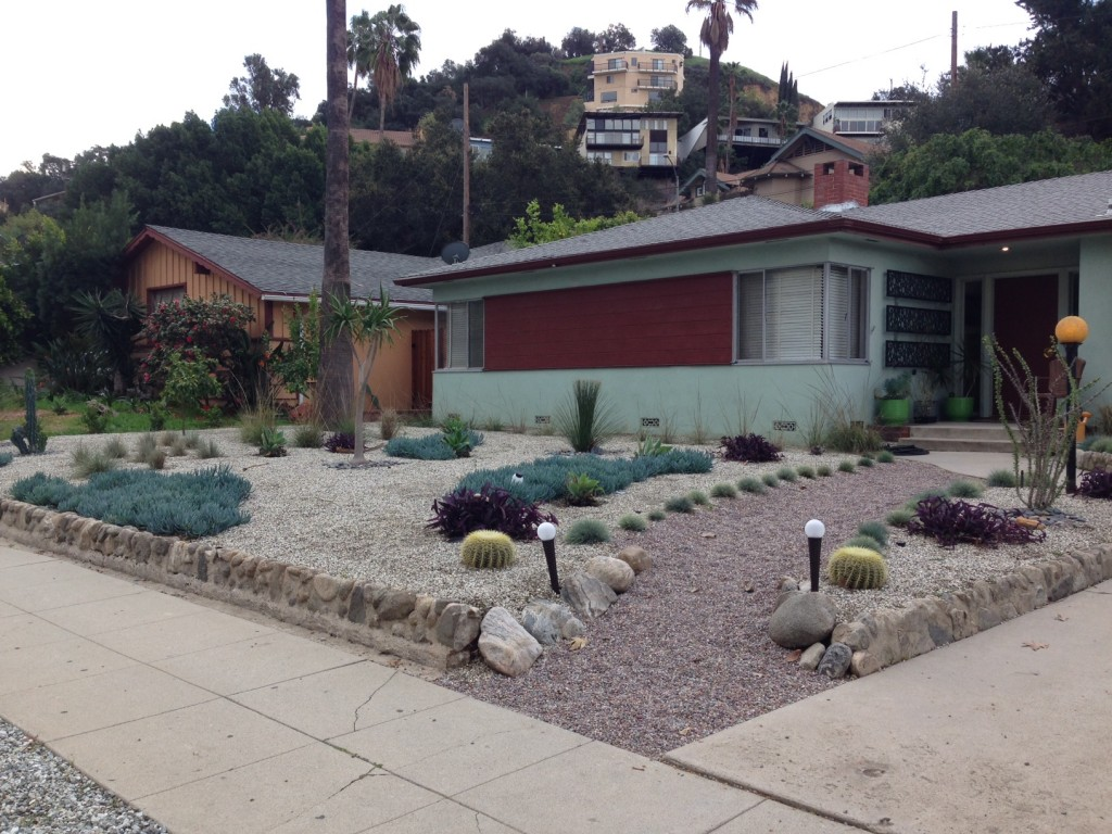 Here is a nice, clean, simple, spare, drought tolerant landscape. THIS.