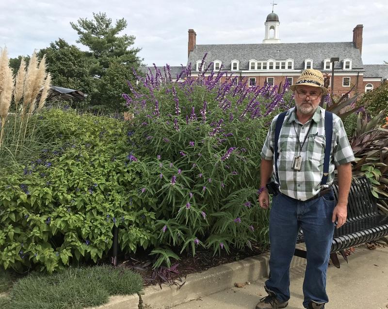 Sam Bahr tends tropicals garden on College Park campus of U.Maryland