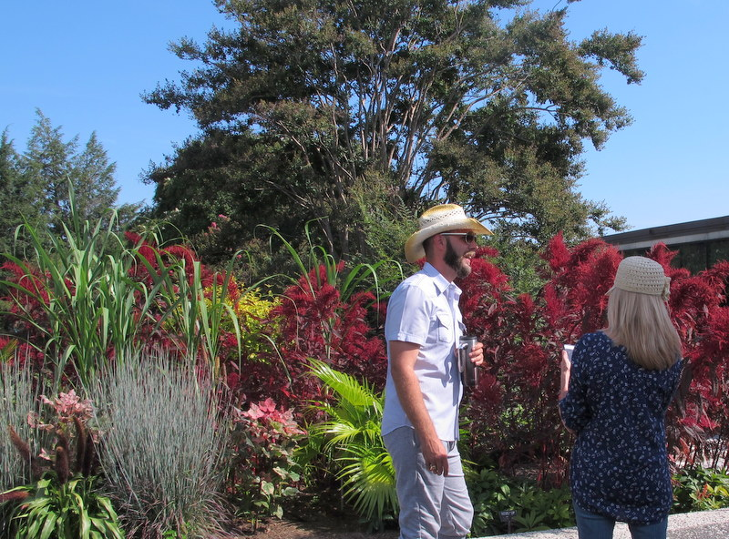 Bradley Evans tends tropicals a National Arboretum garden