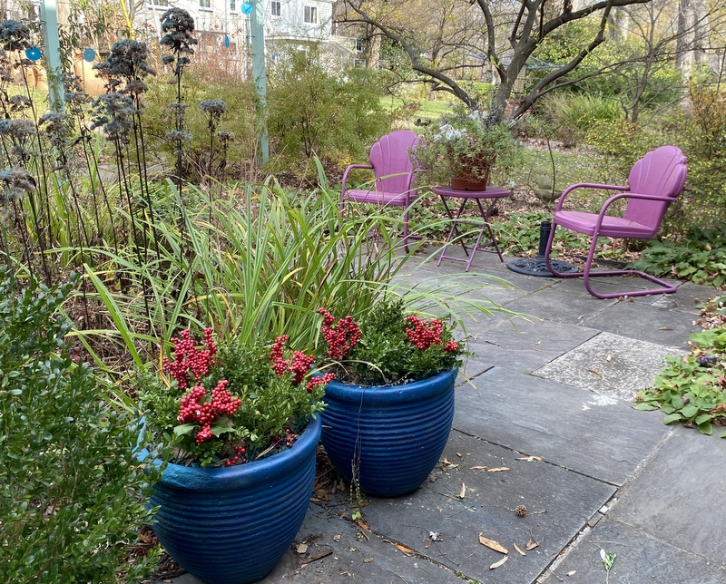 Pots painted blue, with pink chairs