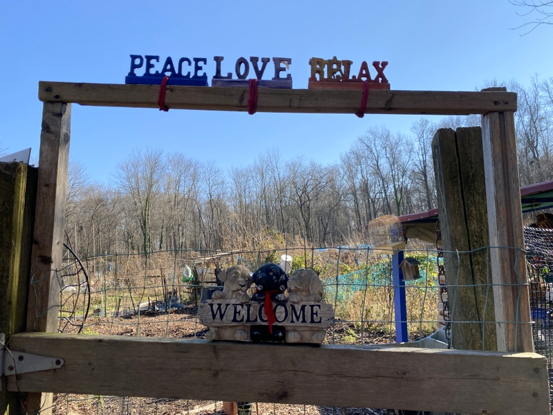 Welcome sign at community garden